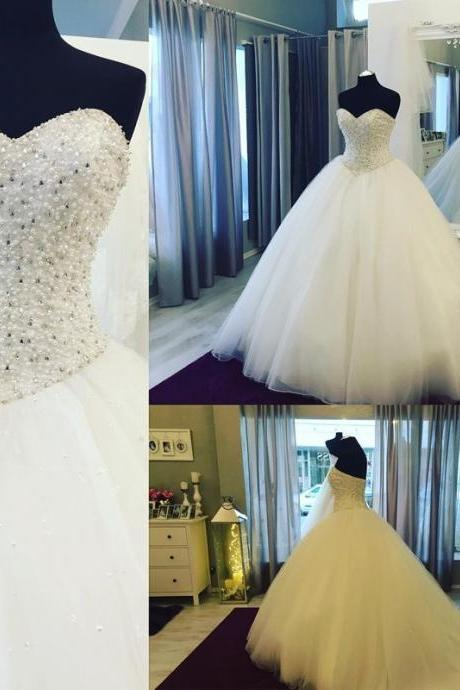 Sleeveless White Ball Gown Wedding Dress with Pearls